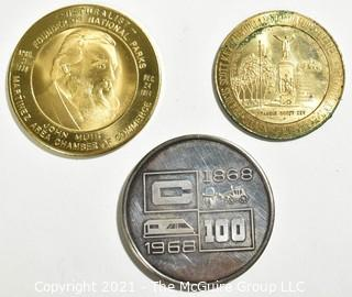 Three (3) Vintage Tokens Including John Muir, Naturalist, Founder of National Parks Medal, 1964-1965. The Maryland Worlds Fair Commission & Bart Bay Area Rapid Transit System Token.
