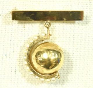 14kt Gold Articulated Globe with Pearl Stand on Gold Bar Brooch.  Weighs 12.3g