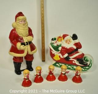 Vintage Christmas Decorations Including Celluloid Santa, Blow Mold Santa and Five Porcelain Angle Candlesticks.