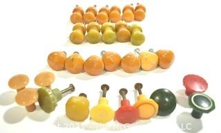 Group of Bakelite Knobs and Drawer Pulls in Red, Green, Yellow and Butterscotch