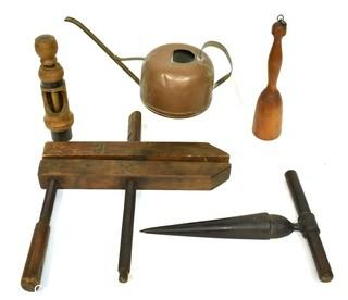 Group of Primitive Tools Including Copper Watering Can, Wood Clamp with Wooden Screws, Cast Iron Reamer, and Wooden Potato Masher. {Note: Description Altered 10.14.2021 @ 6:46pm ET}
