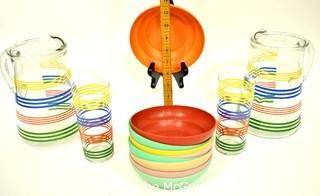 Set of Mid Century Bright Stripe Glassware Pitchers and Tumblers and  Bright Tupperware Bowls.