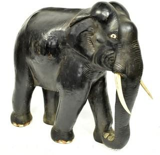 """Large Asian Rosewood Carved Elephant Statue with Bone Tusks.  Measures 9"""" x 18"""" x 21"""". Consignor states it was an artifact in Senate Majority Leader Howard Baker's office."""