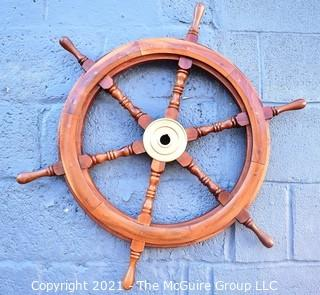 "Authentic Six Spoke Ship's Wheel with Brass Hub.  Heavy.  Measures 29"" in diameter."