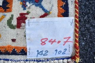 """Vintage Wool Hand Woven Rug with Animal Figures on White Ground.  Measures 40"""" x 58""""."""