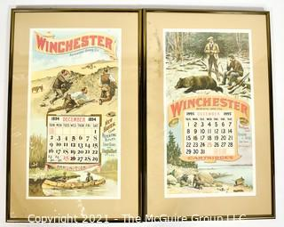 """Two (2) Framed Under Glass Vintage Winchester Repeating Arms And Ammunition Calendars.  They each measure 19"""" long x 12""""."""