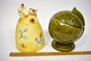 """Two (2) Vintage Pottery Cookie Jars:  Green Globe and Kitten on a Beehive Made in USA.  They measure 11"""" tall."""