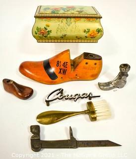 """Collection of Vintage Items Including Lady Figure Shutter Dog, English Bisquit Tin, Victorian Promotional Item from Shoemaker, Shoe Forms and """"Cougar"""" car plate"""