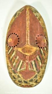 """Hand Carved and Painted Tribal Mask with Pierced Eye Holes, Ethnographic. Measues 14"""" x 6"""""""