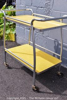 """Mid Century Yellow Formica and Chrome Serving or Bar Cart on Wheels. Measures 19"""" x 28"""" x 32""""."""