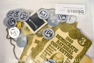 Collection of Pins Buttons and Session Passes from the 1980 Democratic National Convention.