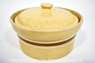 """Vintage Hull Yellow Ware Covered Pottery Crock or Casserole.  Measures 7"""" in diameter."""
