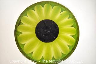 """Mid Century Modern Lucite or Acrylic Large Green Sunflower Made by New Designs Inc, 1969.  It measures 16""""D x 1"""" thick."""