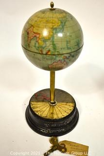 """Antique Sanders Company World Globe Clock with Key.  Clock Face is on stand.  Measures 12"""" tall."""