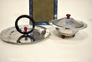 Blue Glass Mirror Frame and Two Chrome and Bakelite Serving Items.