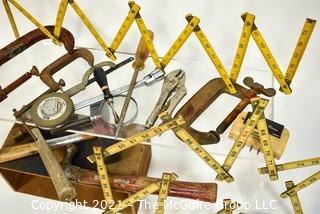 """Assortment of Hand Tools, including folding rules, """"C"""" Clamps, Vise Grips, hammers and mallets."""