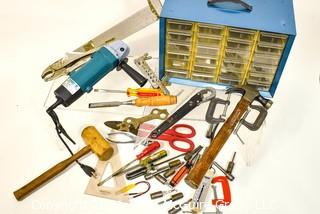 Assortment of tools including wooden mallet, hammer, metal shearing scissors, electric angle grinder and metal screw organizer bin