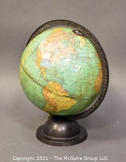 Vintage World Globe on Cast Iron Base.