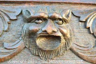 "Antique Victorian Lion Carved Dark Wood Panel. Measures 64"" x 6""."