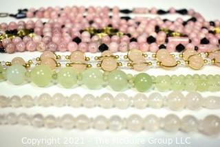 Seven (7) Strands of Mixed Stone Beads Including Bowenite, Rose Quartz and Black Faceted Glass.