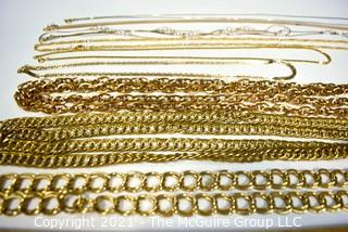 Nine (9) Gold Tone Costume Jewelry Chain Necklaces.
