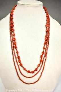 """Two (2) Strands of Red Jasper Beads.  One measures 60"""" long."""