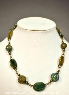"""One (1) Strand Shaped Agate Beads with Bronze Fittings.  Measures 20""""."""