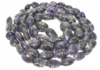 """One (1) Carved Oval Amethyst Strand of Beads.  Measures 40""""."""
