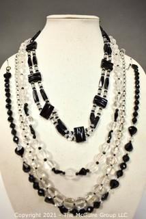 Four (4) Clear and Black Faceted Black Bead Strands.