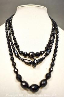 Three (3) Strands of Black Faceted Beads.