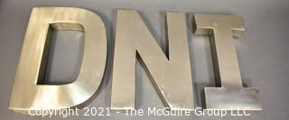 """Three Art Deco Style Commercial Stainless Steel Building or Sign Letters - D N I.  Each measure 10"""" wide and 12"""" tall."""