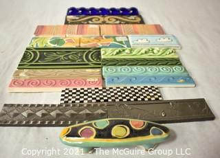 Group of Ceramic Hand Painted Tile Trims Border Pieces in Various Patterns.  Includes one Broken Tile.