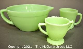 Three (3) Pieces of Vintage Green Jadeite Glassware.  Includes Fire King Mixing Bowl Pitcher With Handle and Mug and Mckee Laurel Double Handle Sugar Bowl.