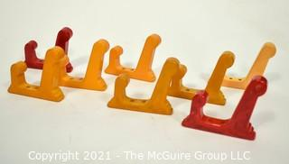 """Set of Eight (8) Vintage Bakelite Wall Hooks in Butterscotch and Cherry Red.  Each measures 3"""" long."""