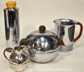 Collection of Mid Century Art Deco Style Chrome Barware.  Includes Chase Tall Cocktail Shaker With Butterscotch Bakelite Top, West Bend Penguin Hot & Cold Server, Bakelite Handled Pitcher and Small Pitcher with Wrapped Handle.
