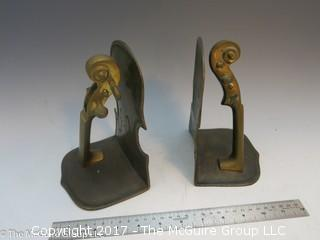 Pair of metal bookends in the form of a violin/cello
