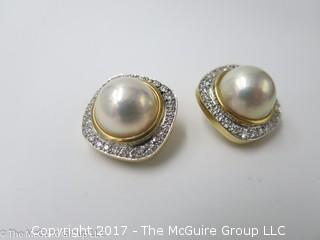 Pair of pearl (9mm x 9mm x 6mm deep)earrings surrounded by diamonds and set in 18k yellow gold; 19.6g; #1220
