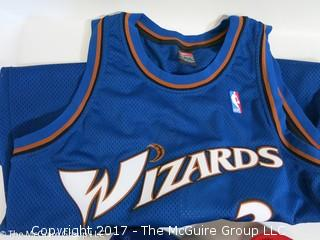 Assortment of sport collectibles including Wizards Jersey signed by Juan Dixon, signed shoe, signed basketball by various Washington Wizards and caps