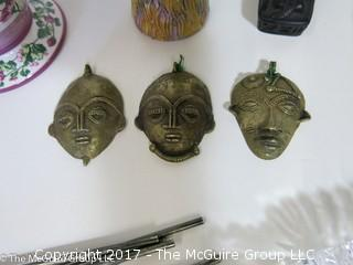 Collection including silver cocktail spoons, ceramics, wall clock and miniature face masks