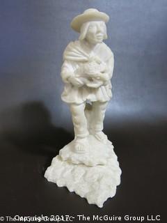 Carved figural sculpture
