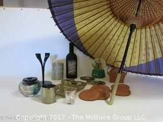 Collection including leather coasters, candles, snow globe, and a large parasol