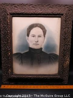 Studio photograph of maiden in period wooden frame