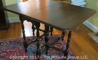 "Gate-leg table: (folded: 15"" x 36""; unfolded: 48"" x 36""; 3 leaves, each 8"")"