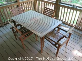 "Teak patio table and set of 4 chairs (kept under cover); 38"" x 62 x 28"" tall"