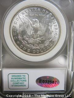 1882 P MORGAN SILVER DOLLAR; SLABBED AND GRADED MS-67 BY NCC