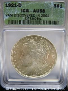 1921 D SILVER DOLLAR; SLABBED AND GRADED AU 58 BY ICG