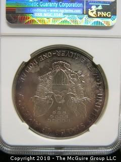 2000 SILVER EAGLE; ARTIFICIAL TONING; SLABBED BY NGC