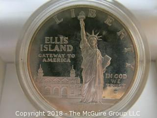 1986 ELLIS ISLAND DOLLAR (NOTE: DESCRIPTION ALTERED 2.10.18)