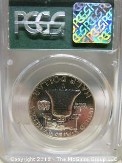 1961 HALF DOLLAR; SLABBED AND GRADED PR 63 BY PCGS