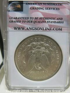 1900 MORGAN SILVER DOLLAR; SLABBED AND GRADED MS 68 BY ANGS